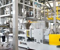 ICMA San Giorgio SpA's Extruders. Each line is capable of producing in excess of 3,000 kg/hr of mineral-filled compounds. The system features energy- saving enhancements and noise deadening properties built into the co-rotating ex